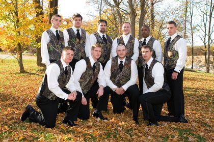 camo themed wedding reception supplies | Camo vest, black ties, no jackets (love this look!)