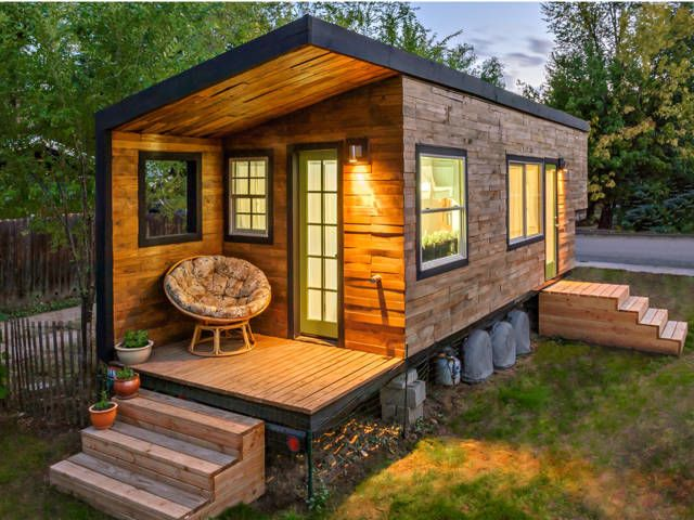 This 196-square-foot house near Boise, Idaho, is home to Macy Miller, her partner James, their daughter Hazel, and their Great Dane, Denver. A 27-year-old architect, Macy designed the home from scratch and built it on a 24-foot flatbed with help from friends and family. Clad in siding made of recycled pallet wood, the minimalist home is flooded with light and feels spacious despite its size.  In total, Macy spent about $11,000 on her tiny house