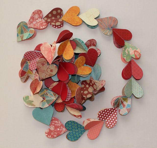 Paper heart garland. Do it yourself by cutting out paper hearts, stack two and sew. #diy #paperheart #garland #valentinesday