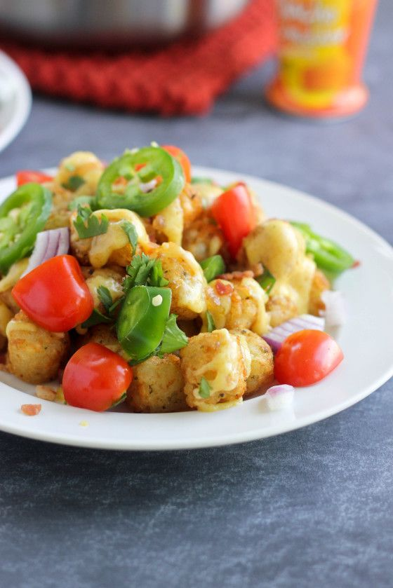 Loaded Tots with Homemade Nacho Cheddar Sauce from @Cassie Laemmli | Bake Your Day