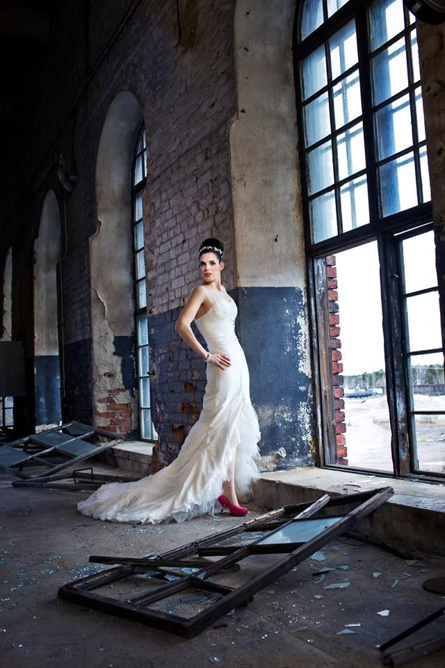 """Another beautiful shot by Oscar Lindell Photography. """"The Stallions""""-dress has an open hemline, the dress is decorated with pearls and hand painted horses and ornaments."""