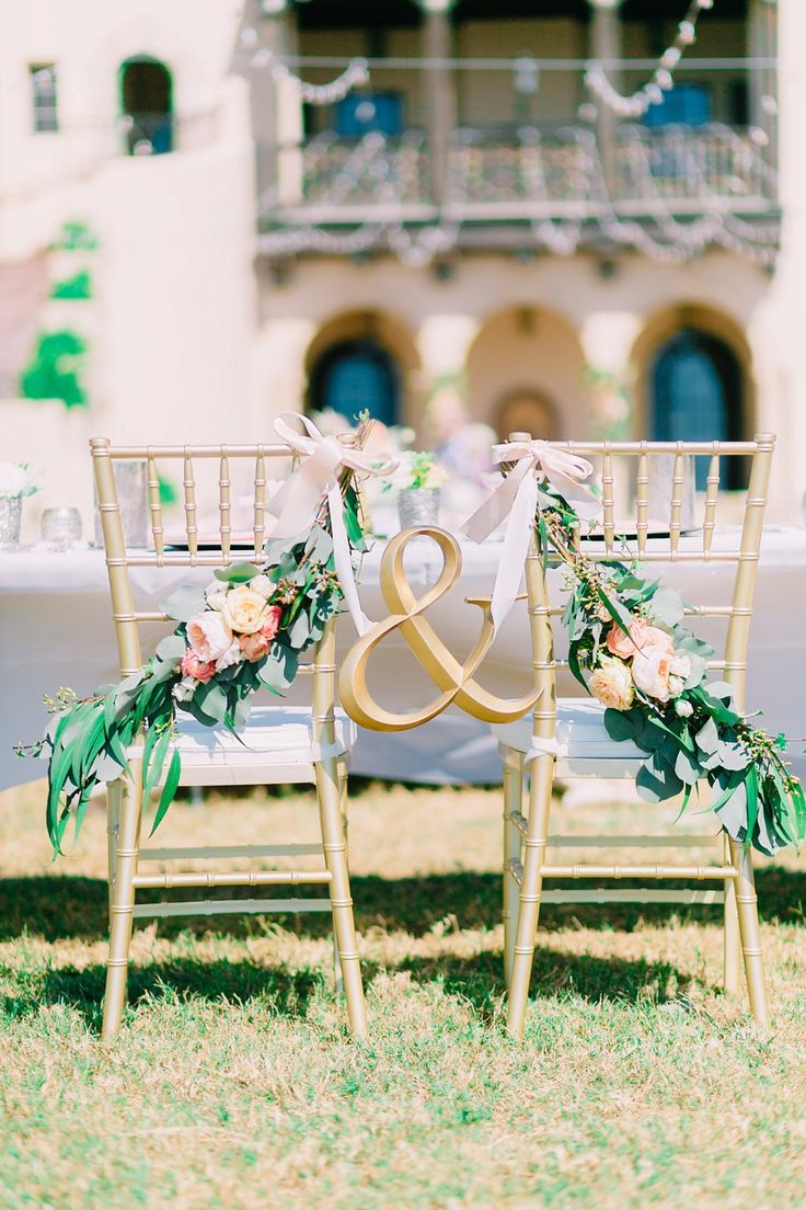 Photography by Catherine Ann Photography | florals by Elegant Designs Floral | Powel Crosley Estate, Sarasota, Florida | gold ampersand chair sign for bride and groom, gold chiavari sweetheart chairs