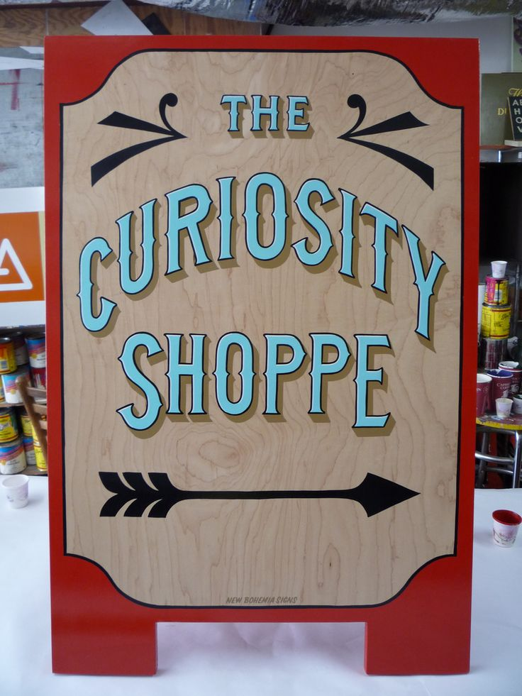 The Curiosity Shoppe sandwich board A-frame sign by New Bohemia Signs design