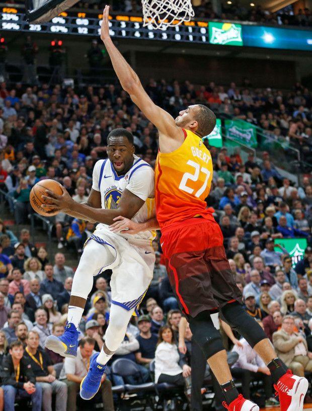 Utah Jazz center Rudy Gobert (27) defends against Golden State Warriors forward Draymond Green, left, in the first half during an NBA basketball game Tuesday, Jan. 30, 2018, in Salt Lake City. (AP Photo/Rick Bowmer)