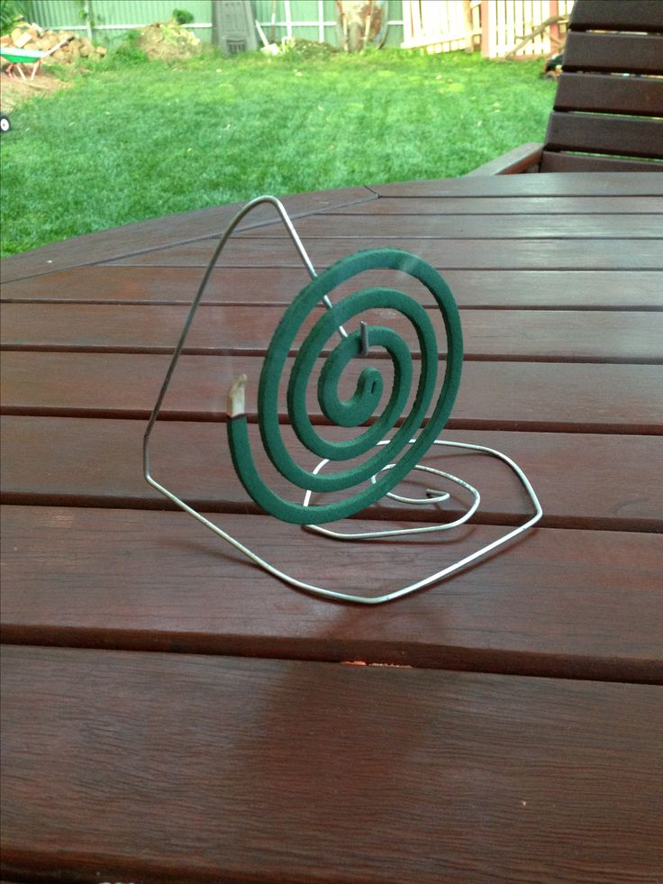 Impromptu Mosquito Coil Holder. Wire coathanger, pointy nose pliers & 3 minutes.