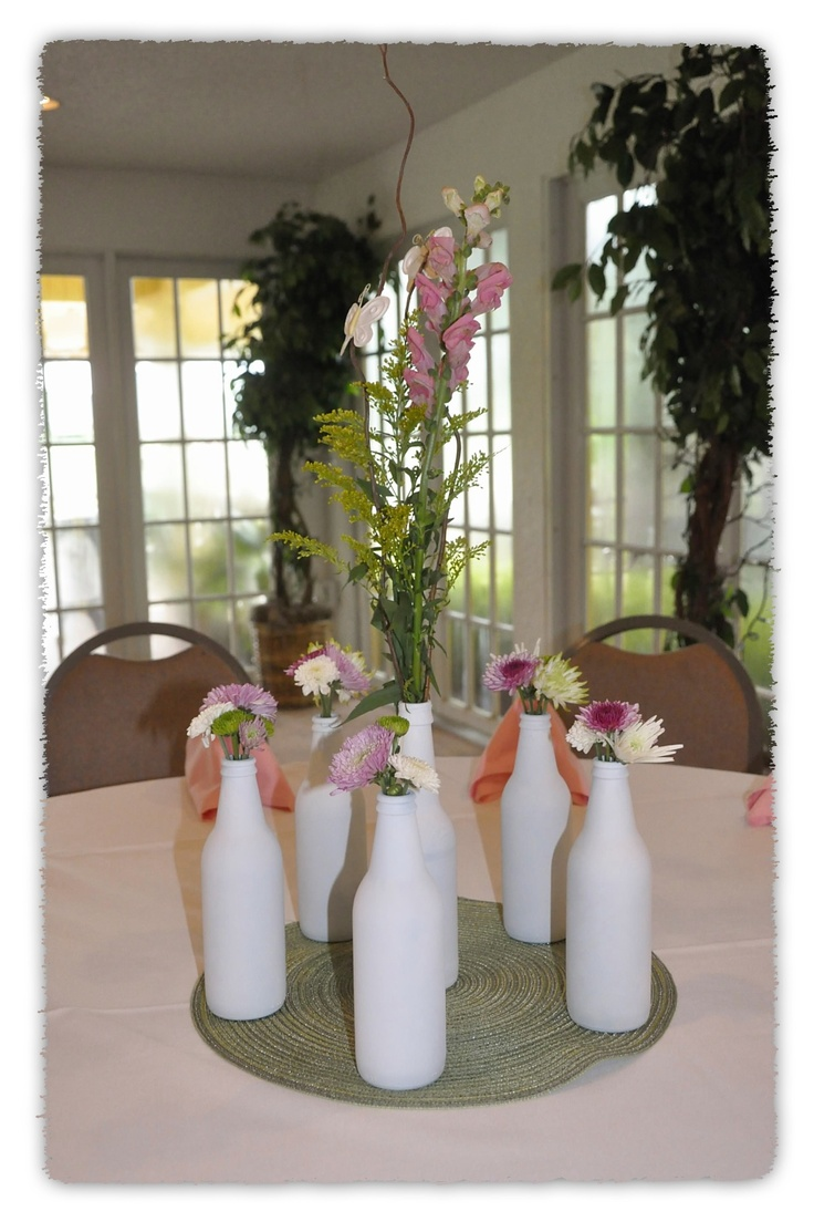 Centerpieces made from spray painting beer bottles white for Baby bottle decoration ideas