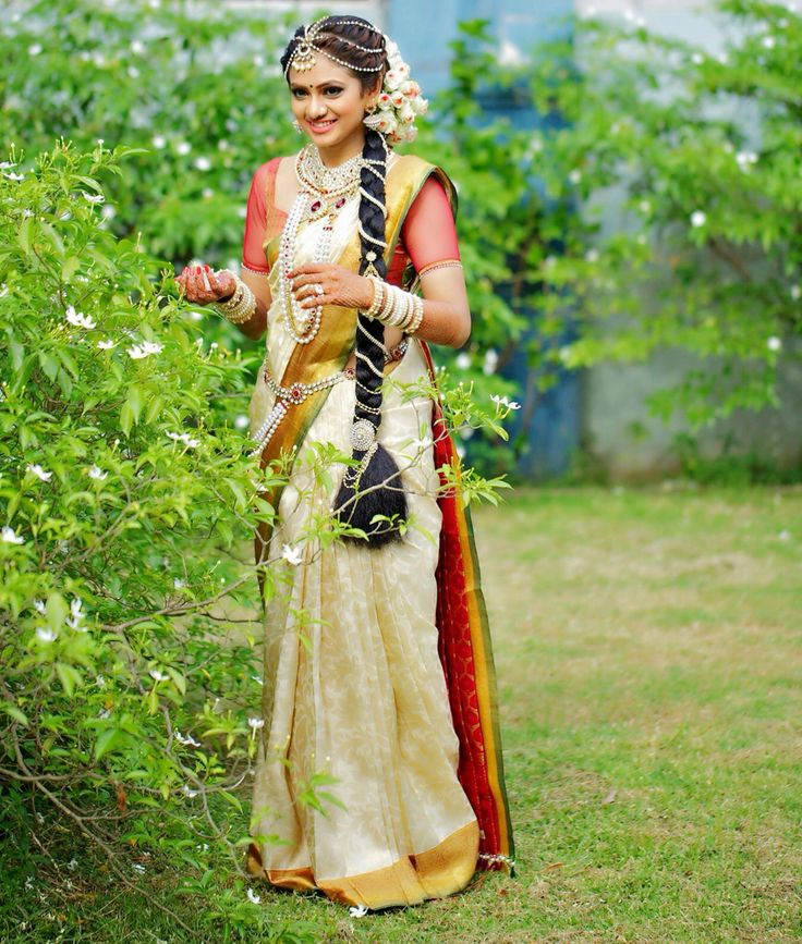 Traditional Southern Indian bride wearing bridal saree, jewellery and hairstyle. #IndianBridalMakeup #IndianBridalFashion South Indian bride. Temple jewelry. Jhumkis.White silk kanchipuram sari.Fishtail side Braid. Tamil bride. Telugu bride. Kannada bride. Hindu bride. Malayalee bride.Kerala bride.South Indian wedding