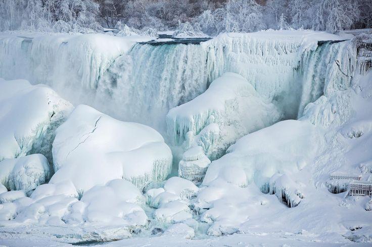 © Lindsay DeDario/Reuters ONTARIO, CANADA A partially frozen American Falls in subfreezing temperatures on Feb. 17  2015 in Niagara Falls, Ontario, Canada.
