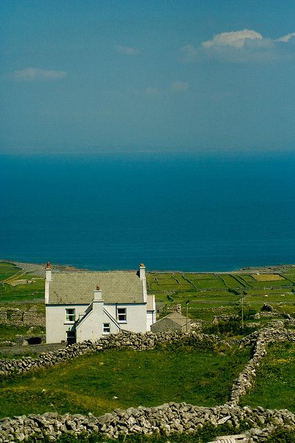 Aran Islands, Ireland.....I would love to live therein that cute white house withe the view and green pastures!!