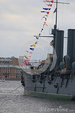 Look along the left board of the historic cruiser Aurora on a cloudy day…