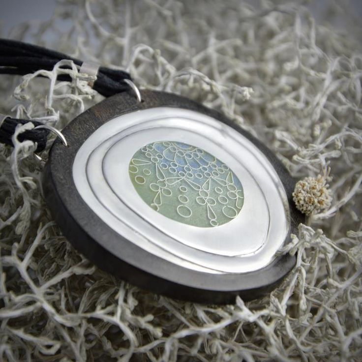 """Silver pendant decorated with subtle ornament made of Georgian enamel called """"Minankari"""" known as Cloisonne. Pendant is frame into ebony wood."""