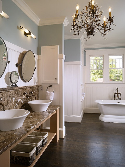 My ideal bathroom. double sinks. large bathtub. dark wide plank wood floors. white and sky blue. elegant and beachy.