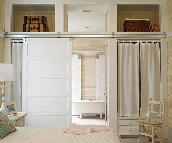 Sliding Barn Door-This door pulls double duty as a wall. A white-paneled sliding barn door functions perfectly in this small master bedroom, separating the bedroom from the master bath. The white door is hung on barn-door rollers, making it easy to slide open and closed.: Closet Doors, Small Master Bedrooms, Sliding Barns Doors, Barn Doors, White Doors, Master Bath, Doors Pull, Pockets Doors, Sliding Doors
