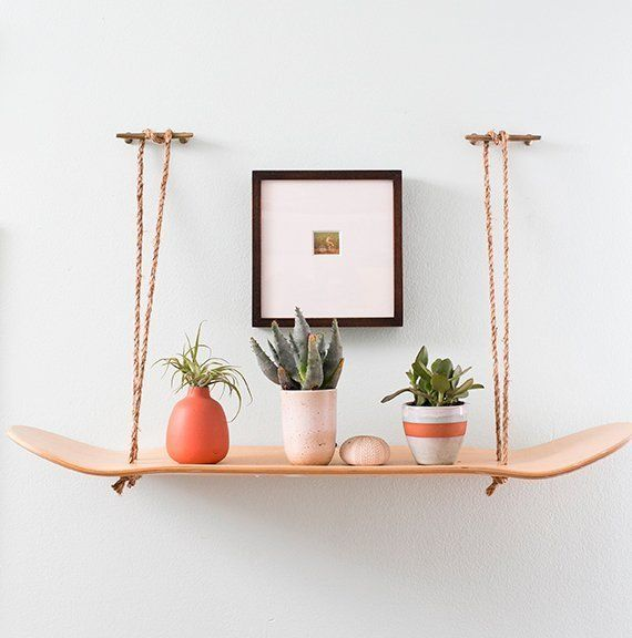 Skateboard shelf- love it  DIY Decor:  5 Projects Using a Skateboard Deck