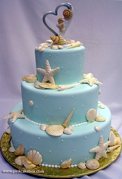 "beach themed wedding cake with seashells and ""our"" wedding cake topper :)"