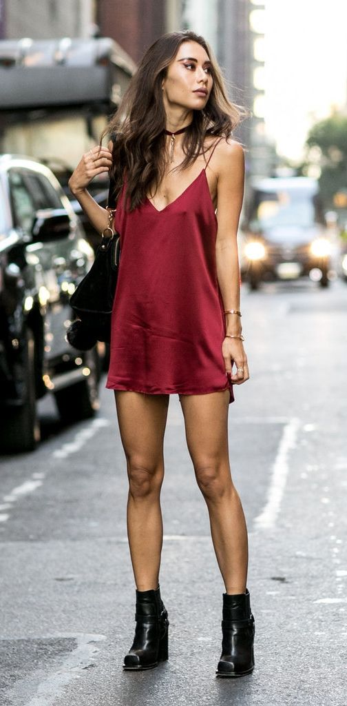 A red slip dress with ankle boots