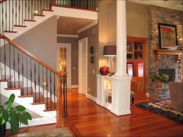 Beautiful greyish brown neutral wall color (family room, kitchen, hallways?) that looks great with both stained wood and white trim