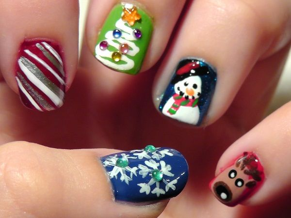 Insert randomness into your Christmas art with these various characters. Color your nails in different nail polish colors and add characters on top such as a snowman and reindeer. You can also add Christmas trees, snowflakes and candy canes.