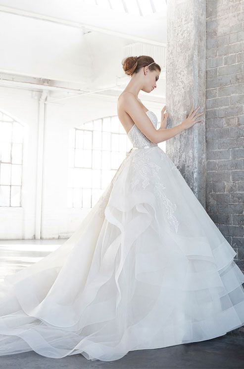 Ivory silk organza floral embroidered bridal ball gown, strapless sweetheart neckline, satin ribbon at natural waist, tiered tulle and organza skirt trimmed with horsehair, chapel train. Lazaro, Spring 2016