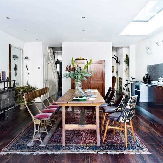 Vintage eclectic kitchen-diner  The vintage and mismatched chairs, worn wooden table and traditional rug create an eclectic look when set next to this modern streamlined kitchen.  Similar chairs  The Old Cinema  Cabinet  Retrouvius  Splashback tiles  Fired Earth