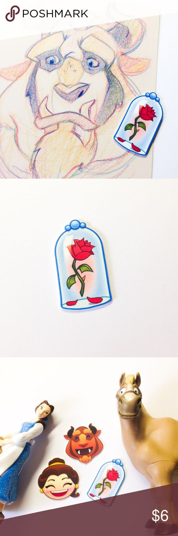 """Enchanted Rose Emoji Pin ***All brooches are 3 for $15, create a bundle and offer $15 - I will accept as soon as I see it, thank you! (Offer applies to all brooches in my closet - mix and match)***  Handmade brooch with an enchanted rose Emoji charm.  We offer 15% off on all bundles. You can """"Add to Bundle"""" to get discount.  Most items listed are ready to ship but if you need something sooner please let us know before ordering.  Thank you for shopping my closet! Magic Main Street Jewelry…"""