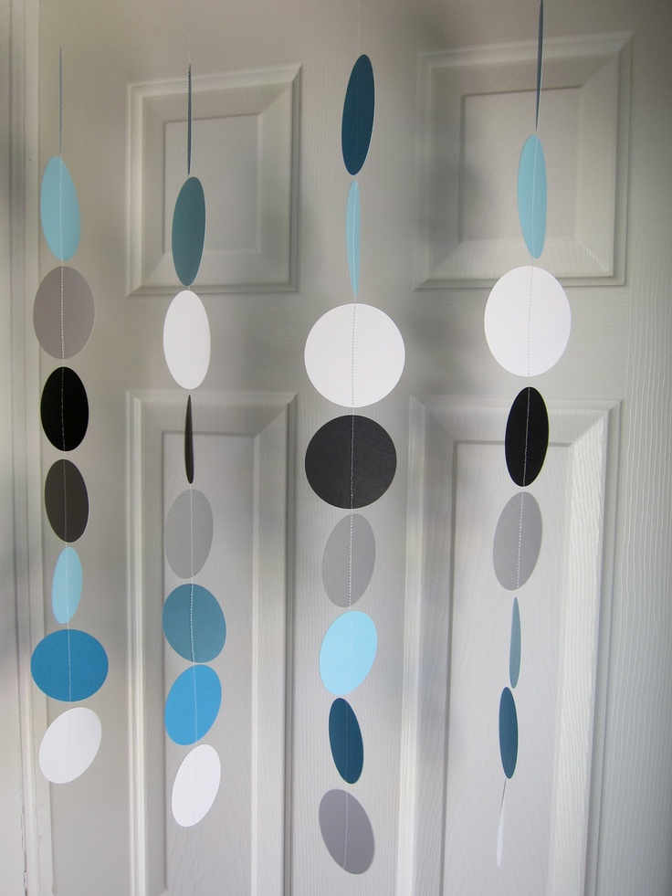 Paper Garland, Blue, Black, Grey, and White Circles Dangling Decorations, Baby Shower Decorations, Birthday, Wedding, Showers. $22.00, via Etsy.