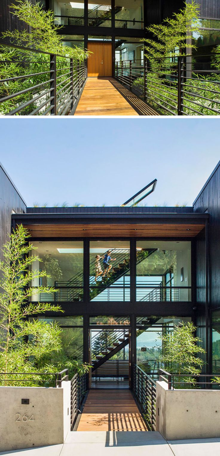 To enter this home, you must pass over a bridge, with a bamboo forest below, that leads from the sidewalk to the main entry.