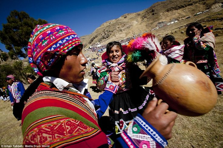 Villagers join hands for a dance and a sing-song at the post bridge-building party. The bridge is believed to be  only bridge still conserved in this traditional Inca fashion