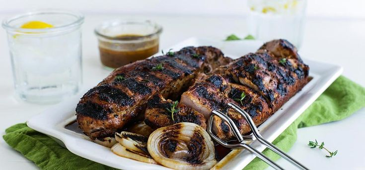 Grilled pork tenderloins are marinated in soy sauce, honey, lemon and Simply Organic® Chop Grilling Seasons to make an irresistibly easy evening entrée.