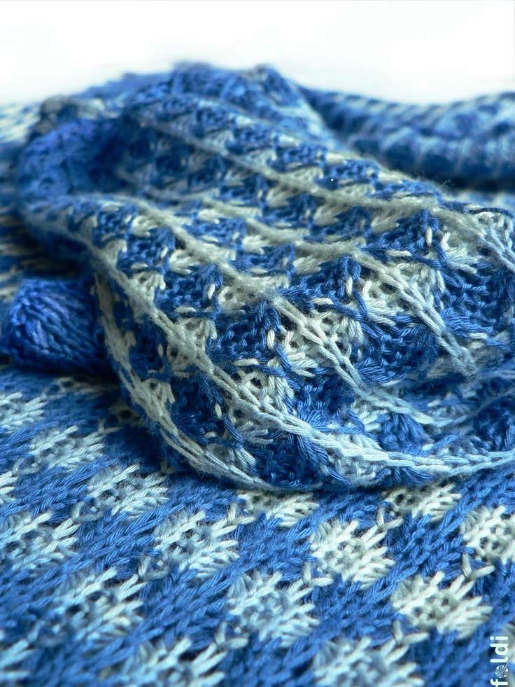 Foldi tuck machine knit shawl.