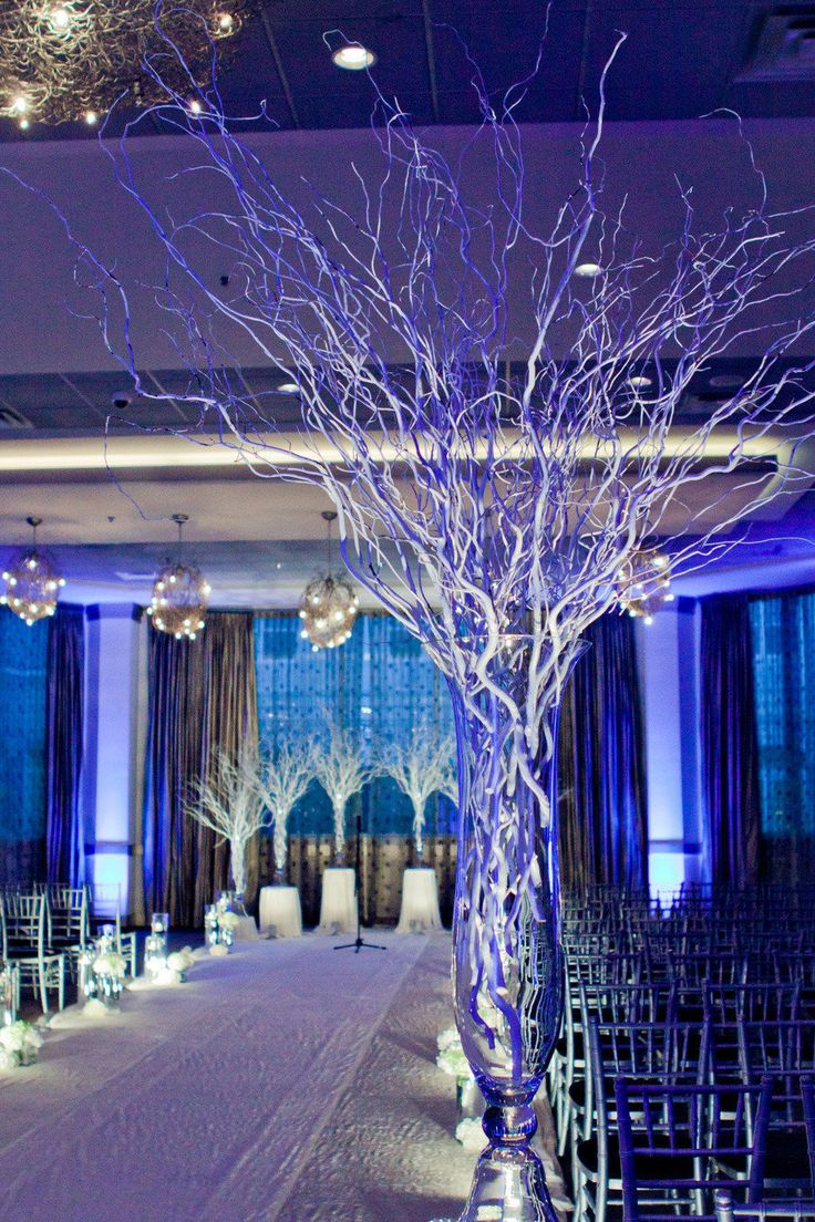 Winter wedding centerpiece. I like this idea for a tall vase and twigs and a candle on top or a light under the vase