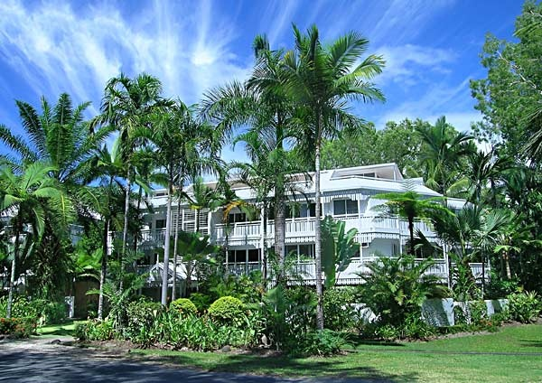 """The White House Holiday Apartments - Port Douglas - """"Port Douglas is the quintessential north Queensland harbour town but with none of the fuss and hurry of bigger places along the coast. The White House Holiday Apartments fit in perfectly here, with their breezy plantation mansion style of shady verandahs and tropical gardens. As you laze on a banana lounge by the landscaped pool with a cold beer in your cooler, you soon see why people love the climate up here."""""""