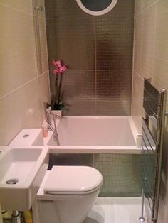 Small Bathroom- love the tub/ shower setup. The small sink bedside the toilet and the metal radiator.. Yes!