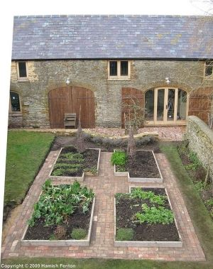 brick  Raised Vegetable Beds | in Backyard Vegetable Garden with house, brick pathway, raised beds ...