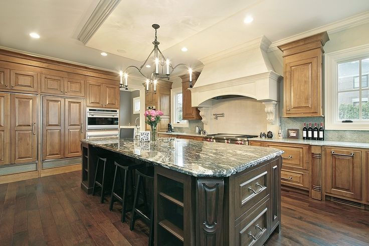 Mediterranean Kitchen with Complex granite counters, Stone Tile, Inset cabinets, L-shaped, Kitchen island, Crown molding