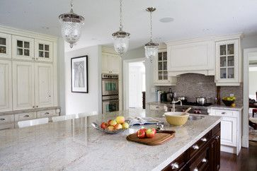 Kashmire White is a great alternate to the oh-so-popular Carrara marble countertops that we are doing so much of right now. It has the same white and grey tones, but since it's a granite you don't have to worry about etching, scratching and staining. The other great thing about Kashmire White is it's a relatively low priced granite!