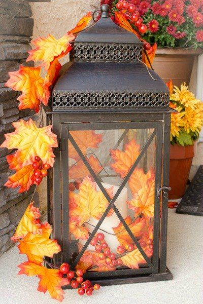 s 10 easy breezy ways to bring fall into every room, home decor, seasonal holiday decor, Add a Lantern Full of Fall to Your Porch