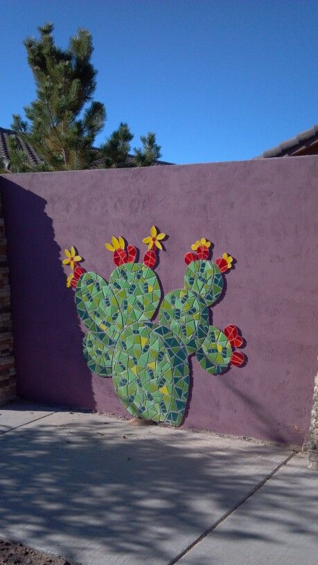 Cactus wall mural made of tile.