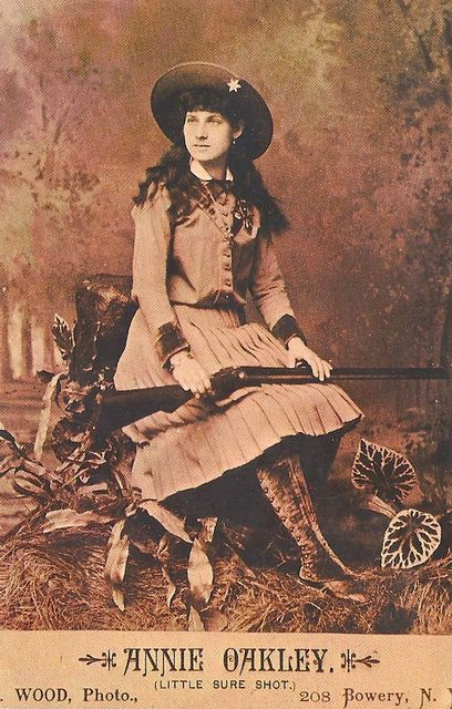 Annie Oakley (1860-1926). Most famous woman marksman of her day. A star with Buffalo Bill's Wild West Show touring the United States and Europe. Sitting Bull also toured with the show but didn't go to Europe.