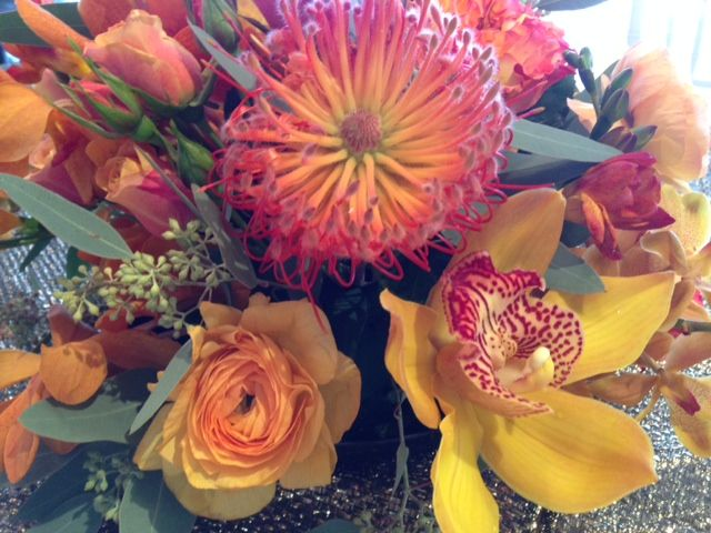 Cymbidium, ranunculus and pincushion protea...