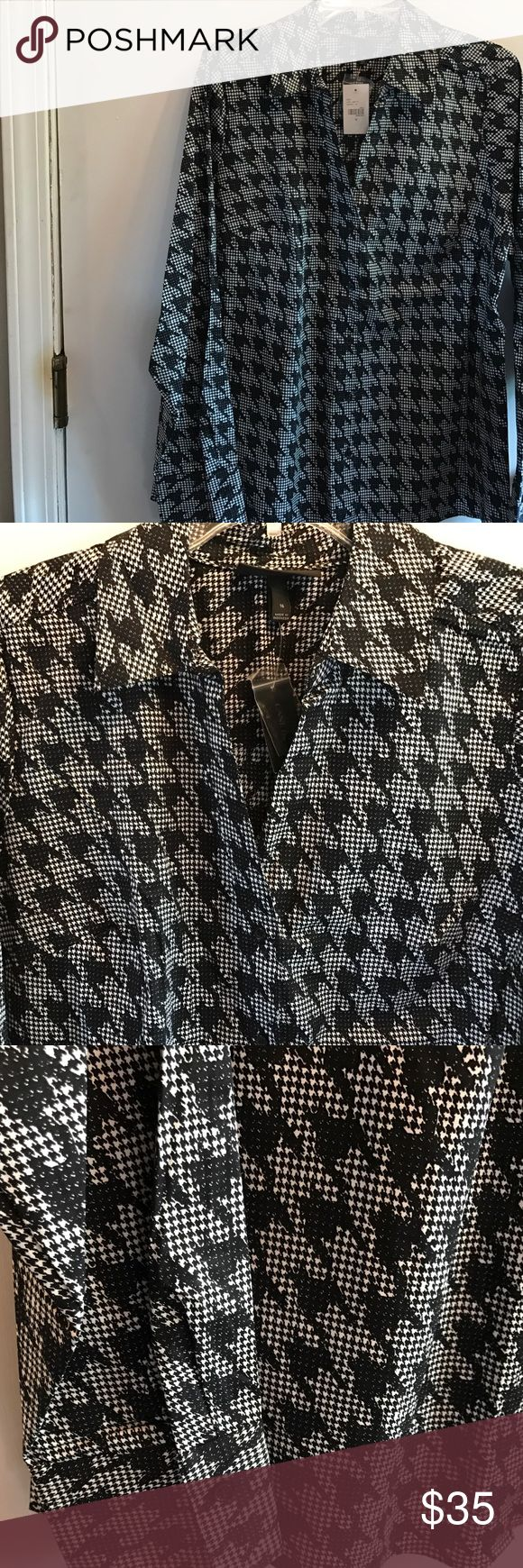 """Lane Bryant NWT black/white herringbone shirt Lane Bryant NWT black/white herringbone print button down v-neck shirt. Sz16 44"""" bust. Long sleeves & Shirt tail hem. Cotton, spandex blend fabric. Wear anytime anywhere with practically anything! The button down shirt is a classic & wardrobe staple! Be sure to check my closet for other similar items. No trades. Lane Bryant Tops Button Down Shirts"""