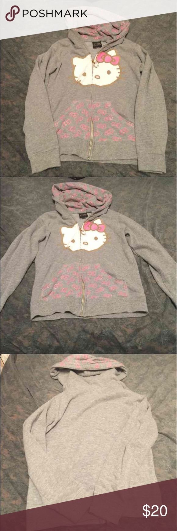 Hello Kitty gray sweatshirt size Large young lady Gray hello Kitty young lady sweatshirt gold hardware with hello Kitty face in good condition pink glitter also on sweatshirt Hello Kitty Shirts & Tops Sweatshirts & Hoodies