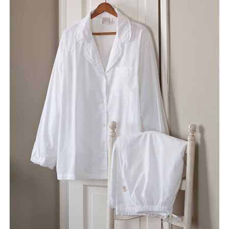 A nightwear staple for hundreds of years - nothing can compare to a crisp white nightshirt or pajama set. It reminds us of something Katherine Hepburn might have worn in Out of Africa perfect. Oh, just so you know, it is a little sheer. But we think that adds to the fun. 100% Cotton. Machine Washable. Pajama sets include a button-down top and draw string bottoms. Small