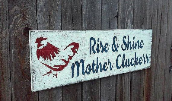 This is a wood sign that measures 24 x 8. The background is painted White. Wording is Navy and chicken design is Tuscan Red.  I will handpaint,