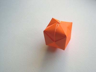"""Origami Water Balloon aka Blow Box:  Lots of links to other origami projects.  GREAT photo guide, especially  nice for beginners.  I'll never forget when my son was addicted to origami, his social studies teacher wrote on his report card, """"R-needs to be directed away from paper cut outs."""" BAHAHA!"""