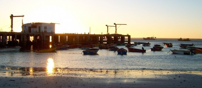 """Port Nolloth, Northern Cape - Characterised by the silhouettes of crayfish trawlers and tankers dredging up diamonds from the ocean floor, Port Nolloth is a small fishing village on South Africa's """"diamond coast""""."""