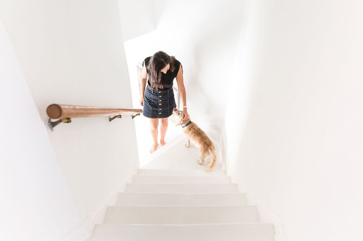 "Before & After: A Stunning Transformation We're Pinning Like Crazy #refinery29  http://www.refinery29.com/small-space-makeover#slide-16  Eddera and her dog, Dudu, pose at the bottom of the stairs. ""This house is great because I really like canyons, but when you're too high up, it's annoying, because you have to use your car. [From here], it takes 10 minutes to be at a restaurant — and I walk a lot, so it's fine!""..."