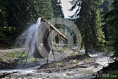 The picture from Rodna mountains (Eastern Carpathians) in northern Romania. A water wheel - the tourist attraction at Iza river source (Izvorul Albastru al Izei)