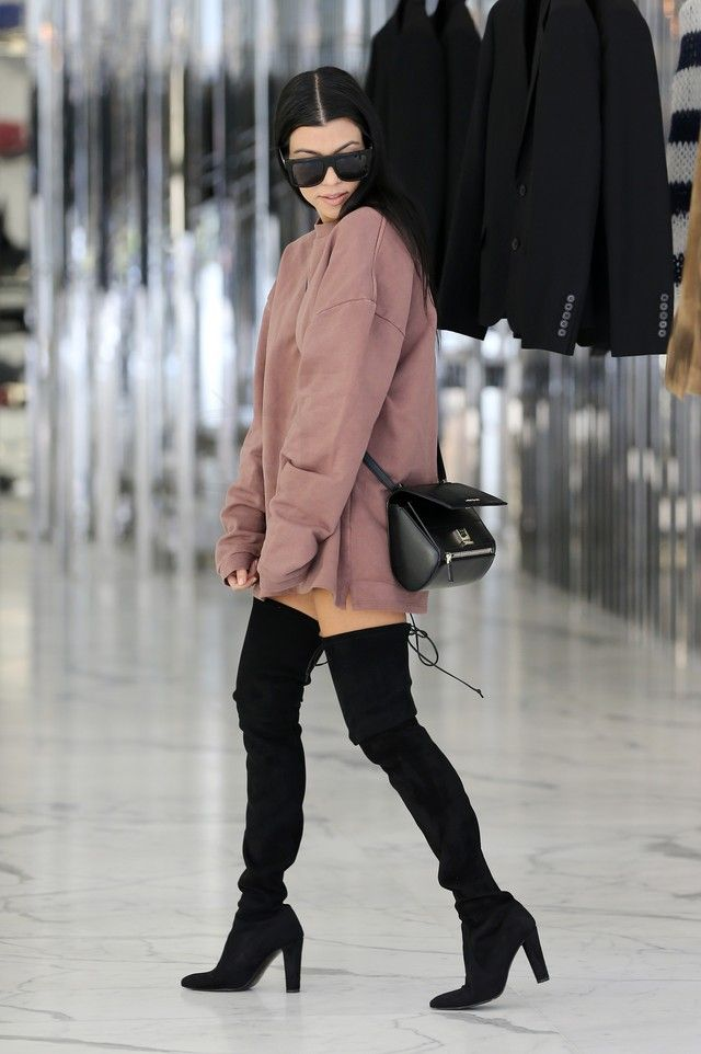 Kourtney Kardashian wearing  Adidas Yeezy Season 1 Oversized Sweater, Givenchy Pandora Mini Patent Shoulder Box, Stuart Weitzman Alllegs Thigh High Boots