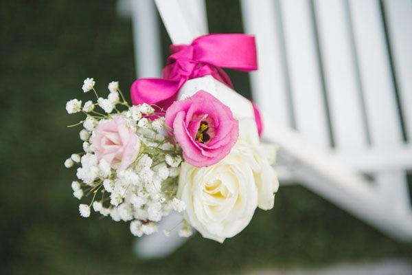 pink and white floral chair decoration http://weddingwonderland.it/2014/10/matrimonio-fucsia-shabby-chic.html